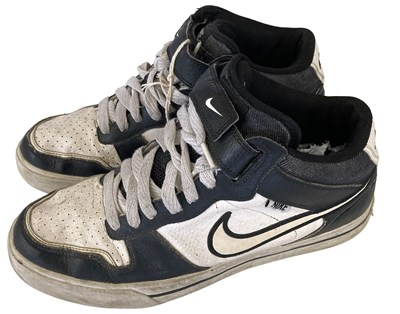 Lot 612 - ED SHEERAN'S OWNED AND WORN NIKE TRAINERS.