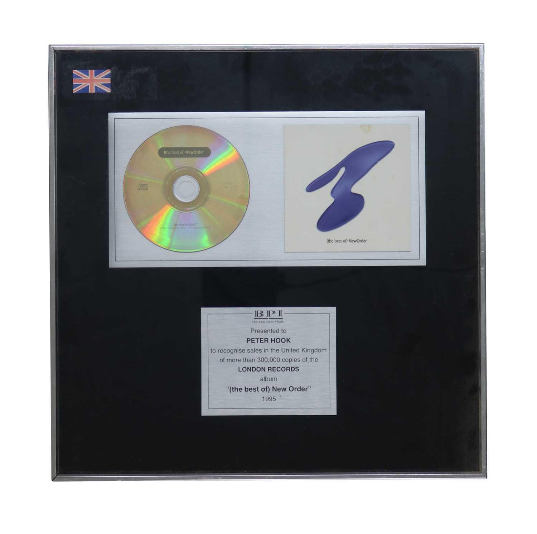 Lot 29 - NEW ORDER (THE BEST OF) NEW ORDER BPI AWARD DISC