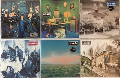Lot 24-OASIS - CREATION 7'' ARCHIVE (SUPERSONIC TO ALL AROUND THE WORLD)
