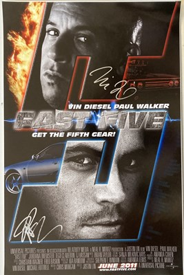 Lot 68 - FAST AND THE FURIOUS - VIN DIESEL AND PAUL WALKER SIGNED.